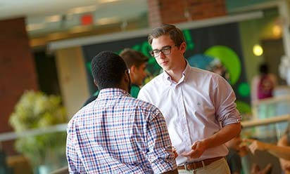 Two young men in conversation at the Student Center.