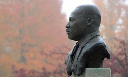 A photo of the MLK statue on campus in the fog.