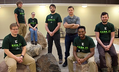A team of EMU physics students pose on the rocks at Mark Jefferson Science Center.