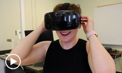 female student wearing virtual reality headset across eyes and face.