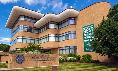 "The exterior of EMU's College of Business Gary M. Owen building,with ""Best Business School"" banner on the bricks."