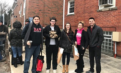 A group of students from the EMU chapter of Beta Alpha Psi deliver Meals on Wheels in Ypsilanti.
