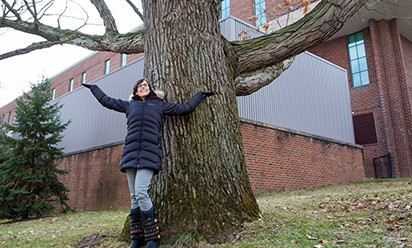 Peggy Liggit stands under her favorite campus oak tree.