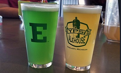 green beer in E glass and amber beer in ypsi alehouse glass