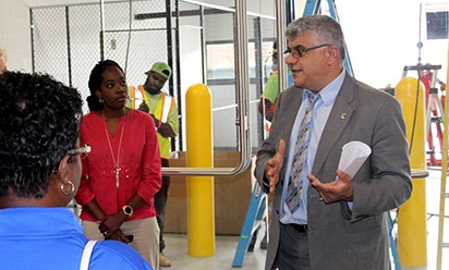 Mohamad Qatu, Dean of the CET leads a tour through the MDOT facility.