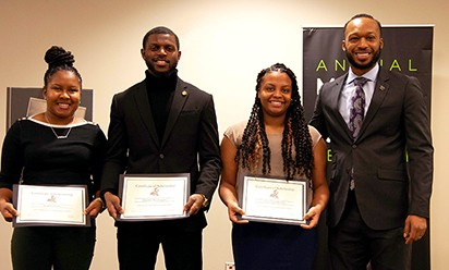 From left: Katrina Seals, Quentin Washington and Chocolate Brooks, essay contest winners with Eric Reed, Director of TRIO.