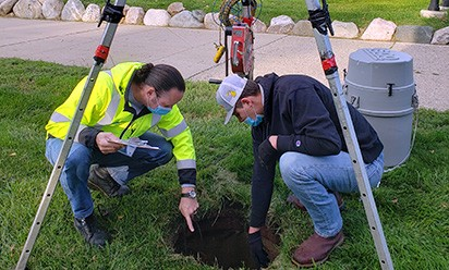 Aquasight team installs wastewater testing equipment on campus.