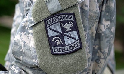 Arm patch of ROTC uniform with Leadership and Excellence insignia