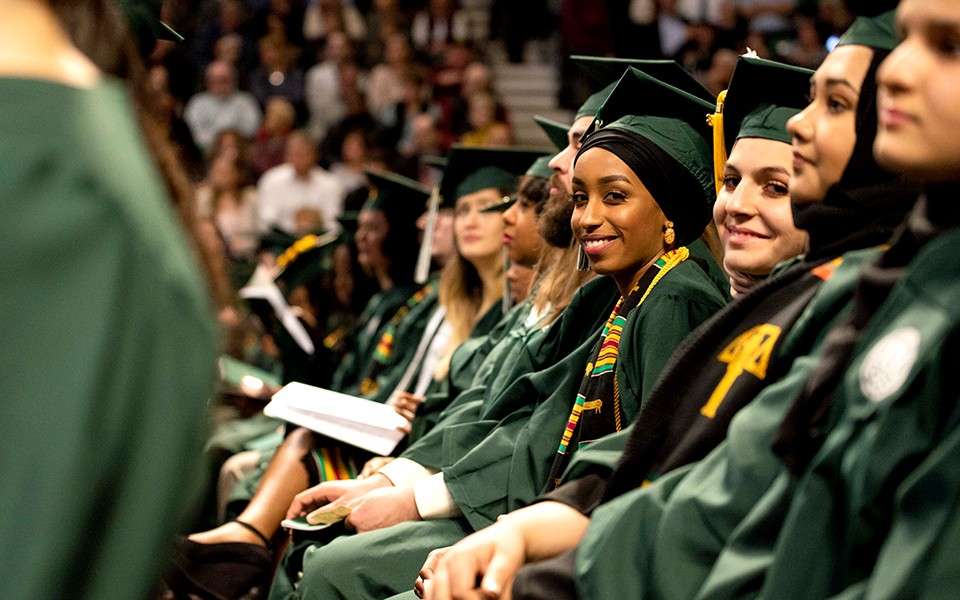 Graduates at commencement ceremony at Convocation Center