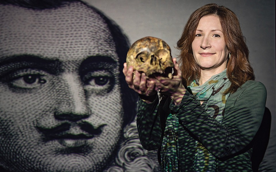 Megan Moore holds General Pulaski's skull in the classroom