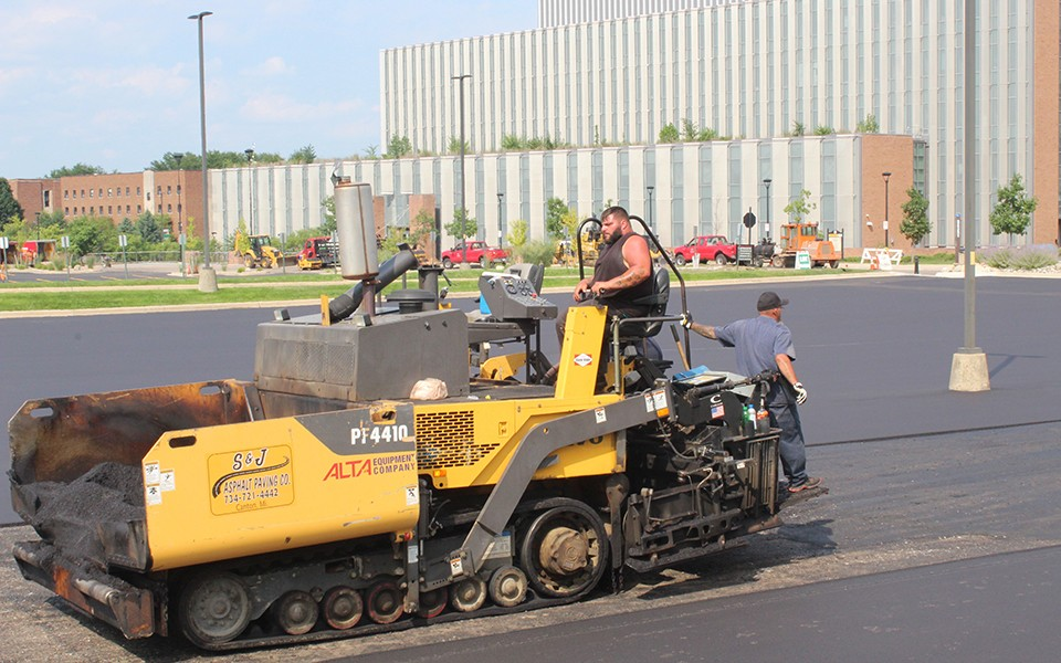Construction crew works on parking lot