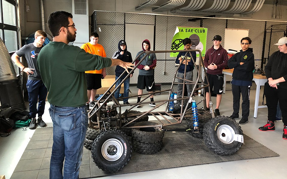 Andrew Mansfield describes the Baja Car to Plymouth-Canton Community High School students on Manufacturing Day.