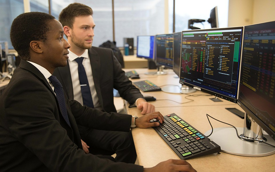Students work on Bloomberg terminals at EMU's College of Business.