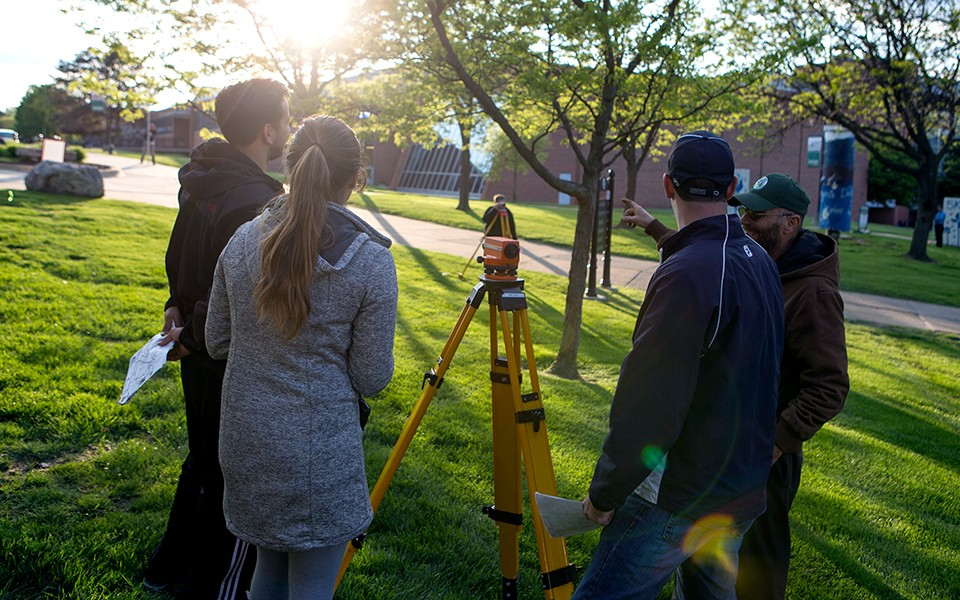 EMU students with surveying equipment