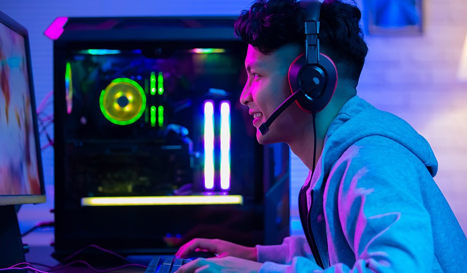 Young man gaming on computer