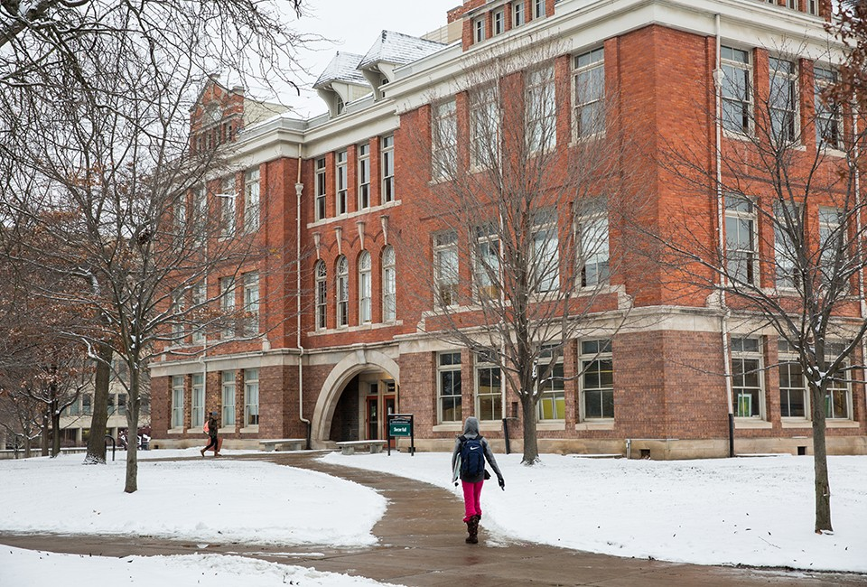 Students walking by Sherzer Hall on EMU's snowy campus