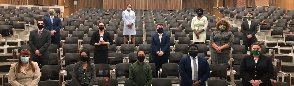 EMU Forensics team wearing masks and distanced in an auditorium