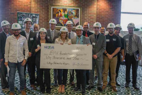 Construction management students pose with check from NEXUS