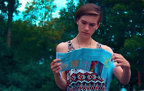 "Screenshot of main character looking at a map from the short film ""Roadmap"""