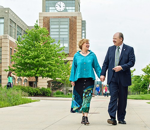 EMU President James Smith and his wife, Connie Ruhl-Smith walking on campus.