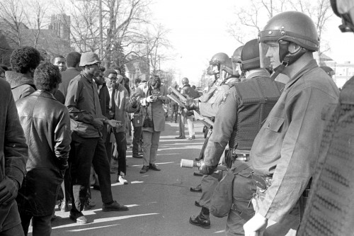 Student and campus police officers face to face in 1969.