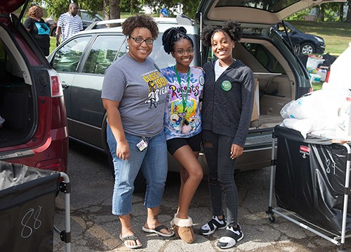 A family on Move-In day at EMU